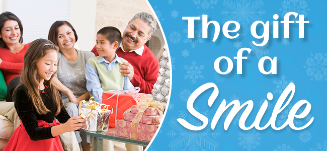 Family giving the gift of a smile during the holidays
