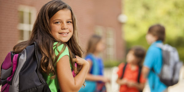 Kid headed back to school with a healthy smile
